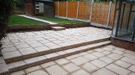 Split level patios and pathway in Kings Norton with sleepers and chip bark.