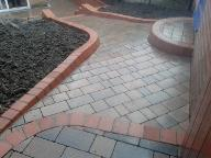 shaped block paving and bull nose steps and path.