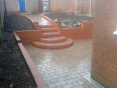 Walls, bullnose shaped step and block paved patio with aco drains in Selly Oak.