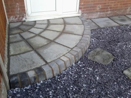 natural stone quadrant step with charcoal bullnose.