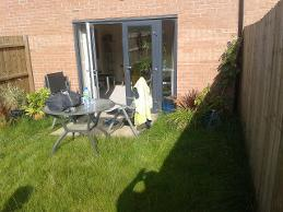 Overgrown and small patio in newbuild in longbridge.