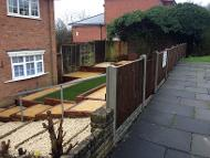 Transformation in Kings Norton, artificial turf, sleepers, slabs and stones.