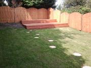 Domed featheredge fencing and double decked decking.
