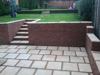patio and walls with railway sleepers.