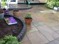 Natural stone paving and bullnose borders in Moseley.