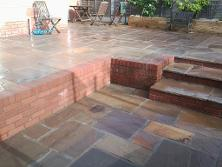 Raj green natural stone with circle and steps in Selly Oak