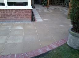 Garden transformed with new 18 inch slabs and red blocks.