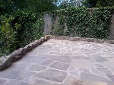 crazy paved patio and sandstone edging in moseley,