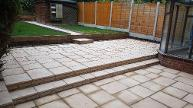 Split level random paving kits with sleepers and new lawns.